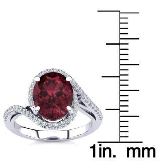 3 1/3 Carat Oval Shape Garnet and Halo Diamond Ring In 14 Karat White Gold