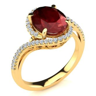 3 1/3 Carat Oval Shape Ruby and Halo Diamond Ring In 14 Karat Yellow Gold