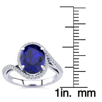 3 1/3 Carat Oval Shape Sapphire and Halo Diamond Ring In 14 Karat White Gold