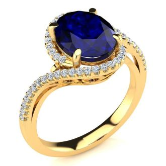 3 1/3 Carat Oval Shape Sapphire and Halo Diamond Ring In 14 Karat Yellow Gold