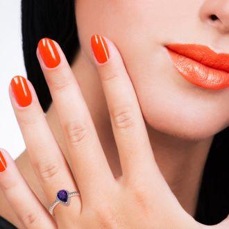 3/4 Carat Pear Shape Amethyst and Halo Diamond Ring In 14 Karat Rose Gold
