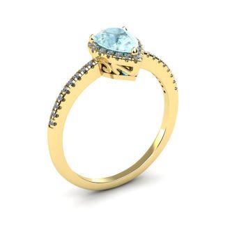 3/4 Carat Pear Shape Aquamarine and Halo Diamond Ring In 14 Karat Yellow Gold