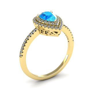 1 1/5 Carat Pear Shape Blue Topaz and Double Halo Diamond Ring In 14 Karat Yellow Gold