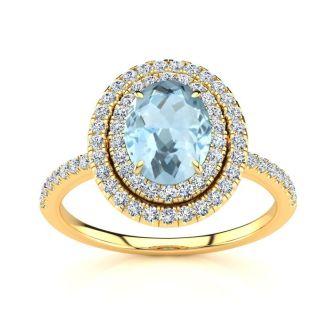 1 1/2 Carat Oval Shape Aquamarine and Double Halo Diamond Ring In 14 Karat Yellow Gold