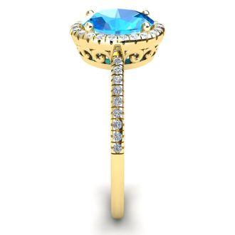 1 3/4 Carat Oval Shape Blue Topaz and Halo Diamond Ring In 14 Karat Yellow Gold