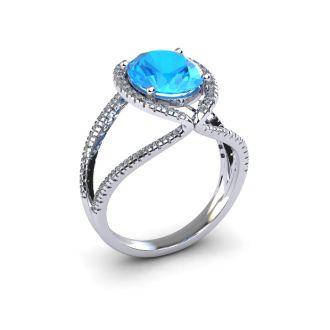 3 3/4 Carat Oval Shape Blue Topaz and Halo Diamond Ring In 14 Karat White Gold