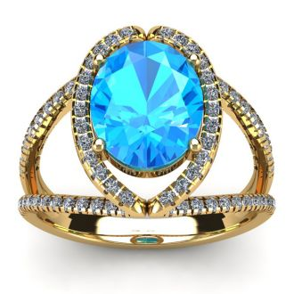 3 3/4 Carat Oval Shape Blue Topaz and Halo Diamond Ring In 14 Karat Yellow Gold