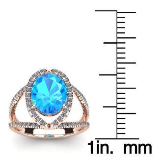3 3/4 Carat Oval Shape Blue Topaz and Halo Diamond Ring In 14 Karat Rose Gold