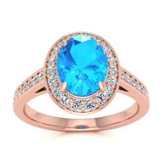 1 3/4 Carat Oval Shape Blue Topaz and Halo Diamond Ring In 14 Karat Rose Gold