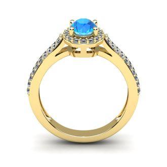 1 1/2 Carat Oval Shape Blue Topaz and Halo Diamond Ring In 14 Karat Yellow Gold
