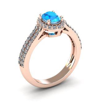 1 1/2 Carat Oval Shape Blue Topaz and Halo Diamond Ring In 14 Karat Rose Gold