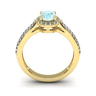 1 1/4 Carat Oval Shape Aquamarine and Halo Diamond Ring In 14 Karat Yellow Gold