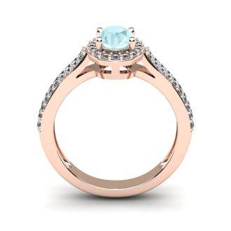 1 1/4 Carat Oval Shape Aquamarine and Halo Diamond Ring In 14 Karat Rose Gold