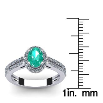 1 1/4 Carat Oval Shape Emerald and Halo Diamond Ring In 14 Karat White Gold