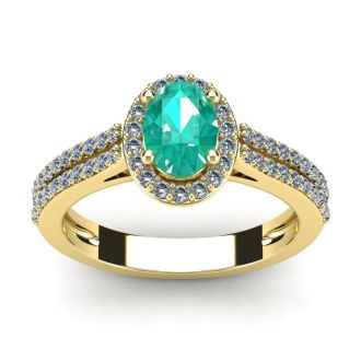 1 1/4 Carat Oval Shape Emerald and Halo Diamond Ring In 14 Karat Yellow Gold