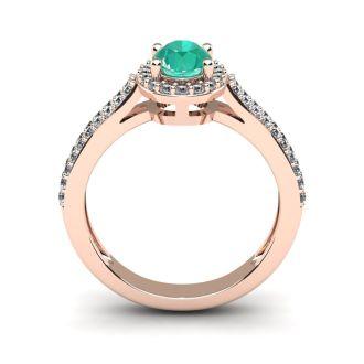 1 1/4 Carat Oval Shape Emerald and Halo Diamond Ring In 14 Karat Rose Gold