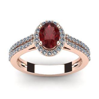 1 1/2 Carat Oval Shape Garnet and Halo Diamond Ring In 14 Karat Rose Gold