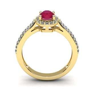 1 1/3 Carat Oval Shape Ruby and Halo Diamond Ring In 14 Karat Yellow Gold