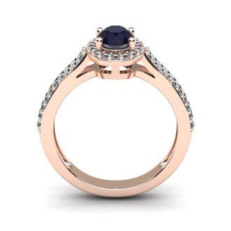 1 1/2 Carat Oval Shape Sapphire and Halo Diamond Ring In 14 Karat Rose Gold