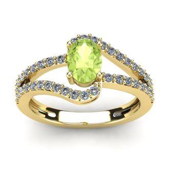 1 1/3 Carat Oval Shape Peridot and Fancy Diamond Ring In 14 Karat Yellow Gold