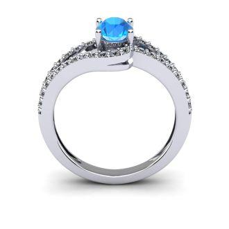 1 1/2 Carat Oval Shape Blue Topaz and Fancy Diamond Ring In 14 Karat White Gold