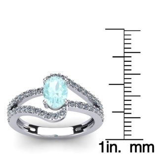 1 1/4 Carat Oval Shape Aquamarine and Fancy Diamond Ring In 14 Karat White Gold