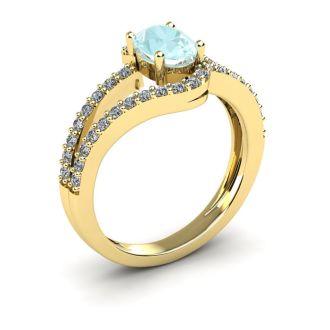 1 1/4 Carat Oval Shape Aquamarine and Fancy Diamond Ring In 14 Karat Yellow Gold