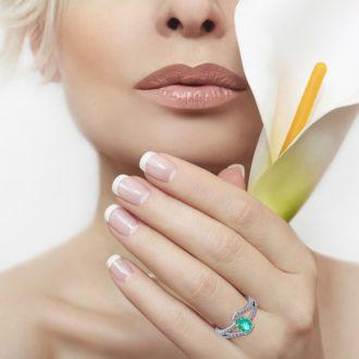 1 1/4 Carat Oval Shape Emerald and Fancy Diamond Ring In 14 Karat White Gold