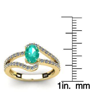 1 1/4 Carat Oval Shape Emerald and Fancy Diamond Ring In 14 Karat Yellow Gold