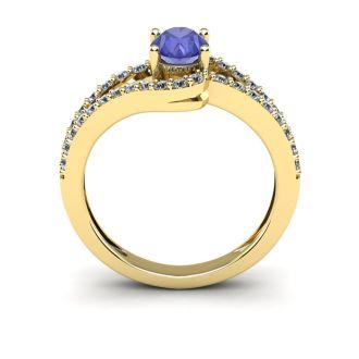 1 1/3 Carat Oval Shape Tanzanite and Fancy Diamond Ring In 14 Karat Yellow Gold