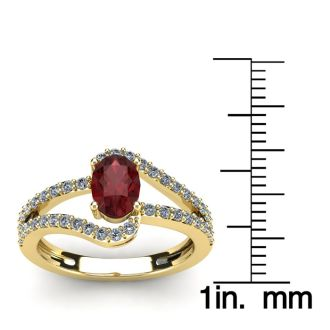 1 1/2 Carat Oval Shape Garnet and Fancy Diamond Ring In 14 Karat Yellow Gold