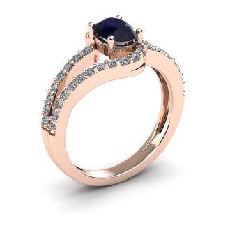 1 1/2 Carat Oval Shape Sapphire and Fancy Diamond Ring In 14 Karat Rose Gold