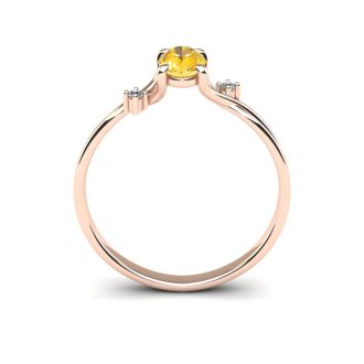 1/2 Carat Oval Shape Citrine and Two Diamond Accent Ring In 14 Karat Rose Gold