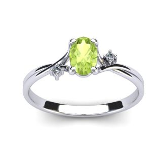 1/2 Carat Oval Shape Peridot and Two Diamond Accent Ring In 14 Karat White Gold