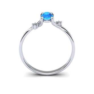 1/2 Carat Oval Shape Blue Topaz and Two Diamond Accent Ring In 14 Karat White Gold