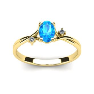 1/2 Carat Oval Shape Blue Topaz and Two Diamond Accent Ring In 14 Karat Yellow Gold
