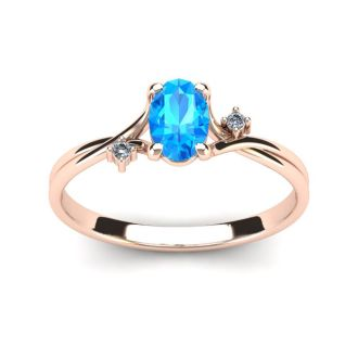 1/2 Carat Oval Shape Blue Topaz and Two Diamond Accent Ring In 14 Karat Rose Gold