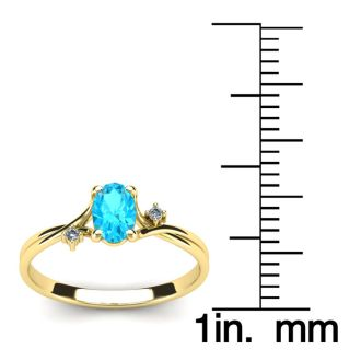 1/2 Carat Oval Shape Aquamarine and Two Diamond Accent Ring In 14 Karat Yellow Gold