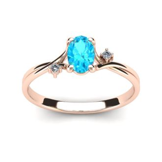 1/2 Carat Oval Shape Aquamarine and Two Diamond Accent Ring In 14 Karat Rose Gold