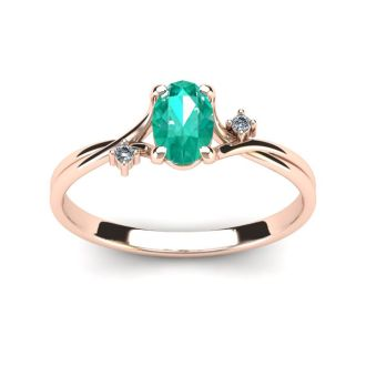 1/2 Carat Oval Shape Emerald and Two Diamond Accent Ring In 14 Karat Rose Gold
