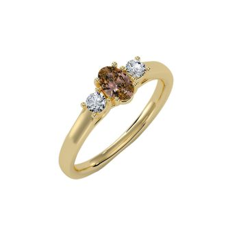 1/2 Carat Oval Shape Citrine and Two Diamond Ring In 14 Karat Yellow Gold