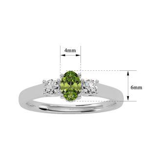 3/4 Carat Oval Shape Peridot and Two Diamond Ring In 14 Karat White Gold
