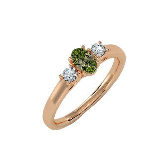 3/4 Carat Oval Shape Peridot and Two Diamond Ring In 14 Karat Rose Gold