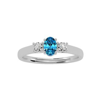 3/4 Carat Oval Shape Blue Topaz and Two Diamond Ring In 14 Karat White Gold