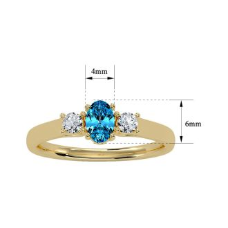 3/4 Carat Oval Shape Blue Topaz and Two Diamond Ring In 14 Karat Yellow Gold