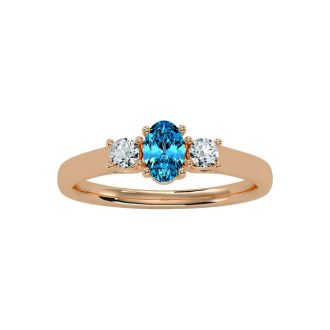 3/4 Carat Oval Shape Blue Topaz and Two Diamond Ring In 14 Karat Rose Gold