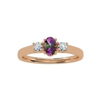 3/4 Carat Oval Shape Mystic Topaz and Two Diamond Ring In 14 Karat Rose Gold