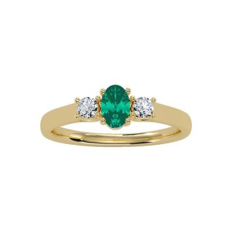 1/2 Carat Oval Shape Emerald and Two Diamond Ring In 14 Karat Yellow Gold