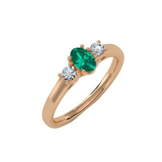 1/2 Carat Oval Shape Emerald and Two Diamond Ring In 14 Karat Rose Gold