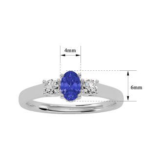 3/4 Carat Oval Shape Tanzanite and Two Diamond Ring In 14 Karat White Gold